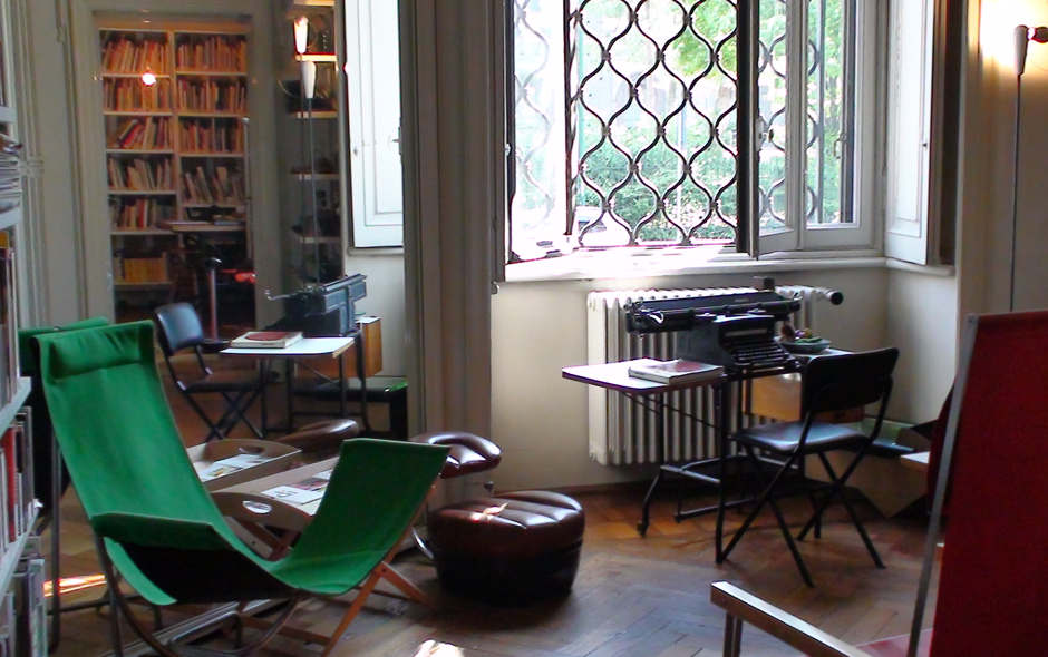 3/7 The drawing room filled with his designs including the 40/80 chair (left) and the Sella stool (reflected in mirror) produced by Zanotta.