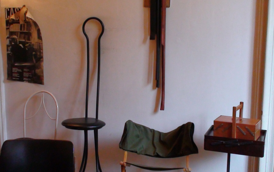 5/7 A line-up of chairs including the Spluga stool (second from left), that was designed with his brother Pier Giacomo for a Milanese bar and is still produced by Zanotta.