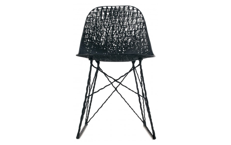 3/3 Designed in collaboration with Marcel Wanders, the Carbon Chair is knotted and hand coiled and 'fixed' with epoxy resin.