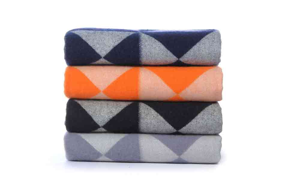 2/7 Geometric throws designed by Verner Panton in the 1970s and first produced by Swiss textile group Mira-X