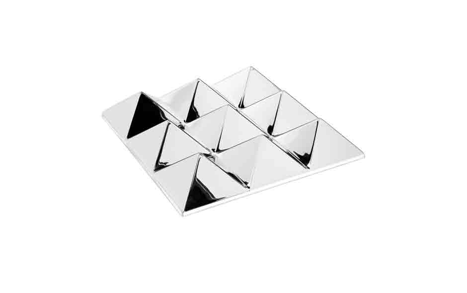 6/7 The Verner Panton sculptural mirror, in either one, four or nine pyramid combinations, is a play on reflection.