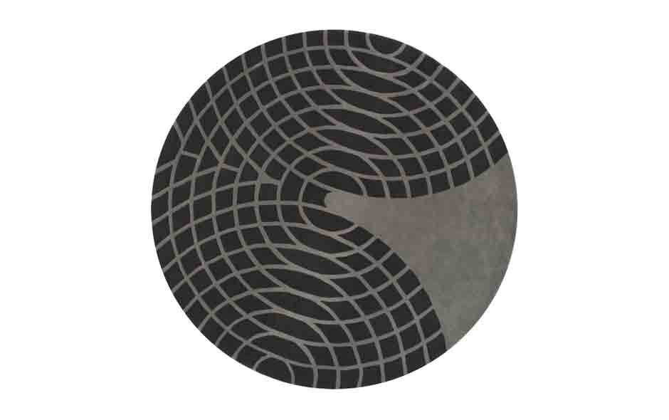5/7 The Grande Round rug designed by Verner Panton in 1975 is 2 metres in diameter and made from hand-tufted wool.