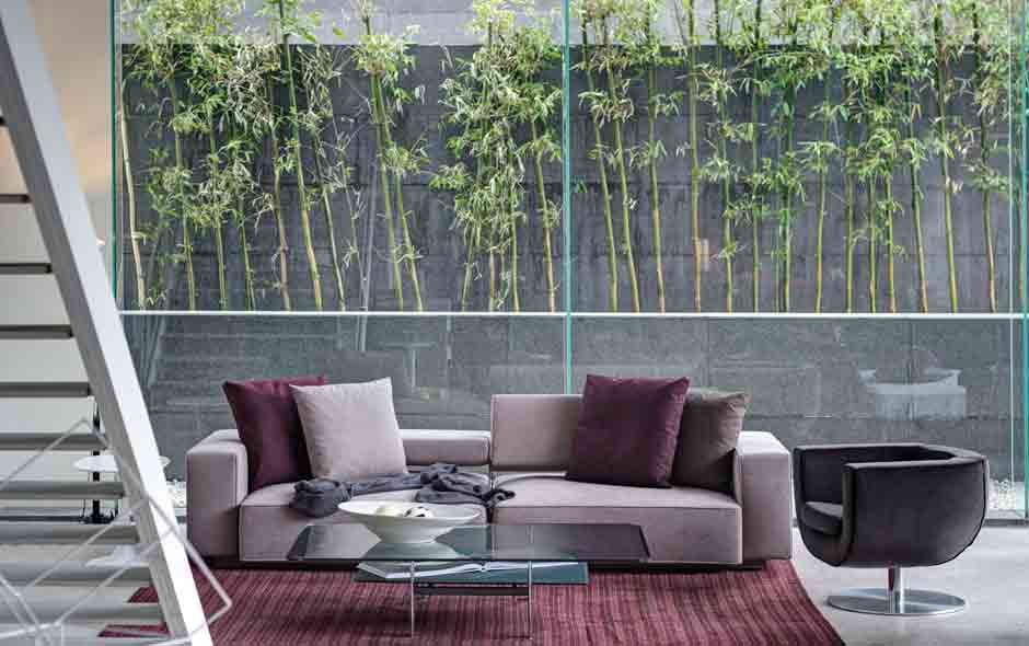 3/4 The Andy sofa by Antonio Citterio and Tulip swivel chair by Jeffrey Bernett.