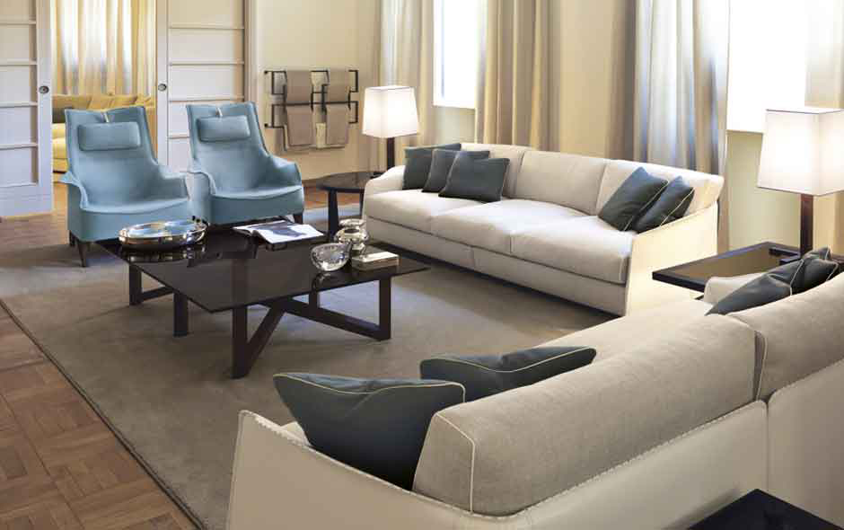 8/8 The Mobius wing chair in powder blue saddle leather by Umberto Asnago with the Fabula sofa in leather and upholstered linen cushions.