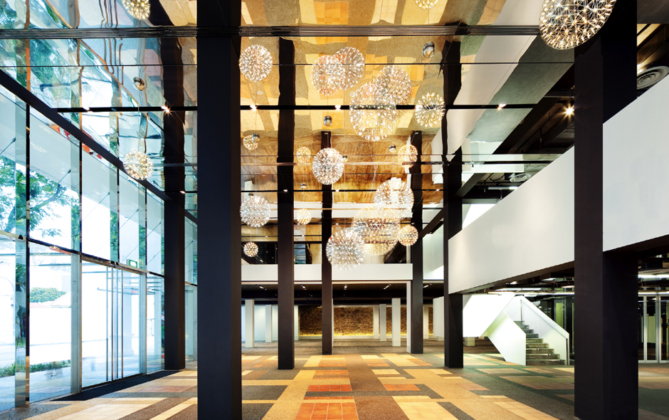 2/7 Inside the new Glass Block building filled with Moooi's Raimond lights looking towards Heritage House.
