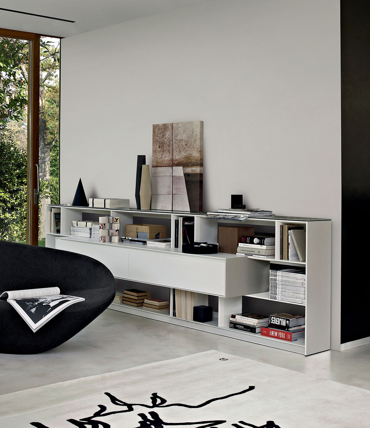 The  Flat C storage system  by Antonio Citterio for B&B Italia was designed to house entertainment systems and books in the smallest space possible.