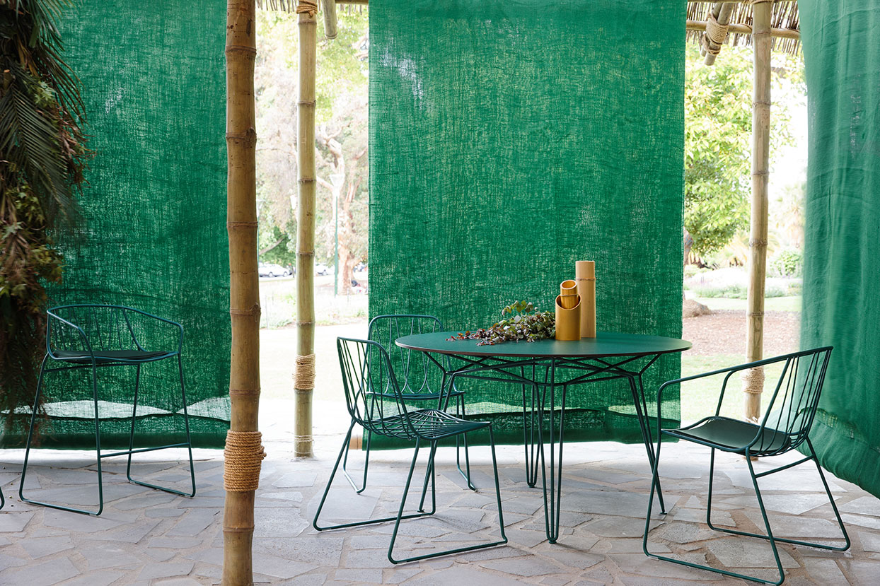 The SP01 Design Chee Chair collection and Parisi table in green.
