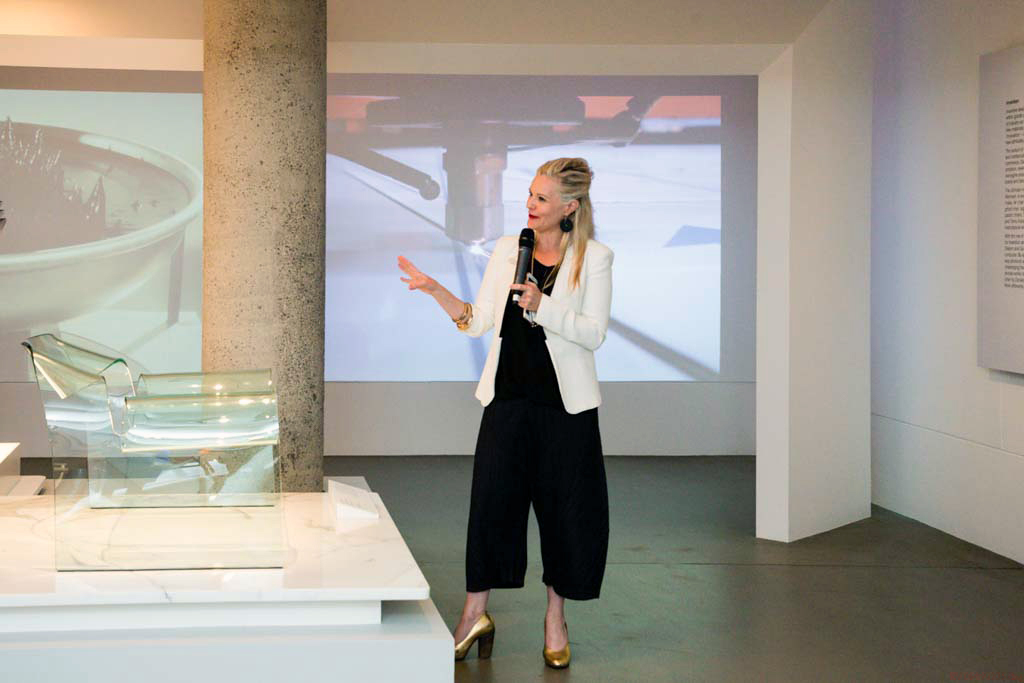 Simone LeAmon, Curator,Contemporary Design and Architecture, with the Ghost chair by Cini Boeri and Fiam. Photo courtesy NGV.