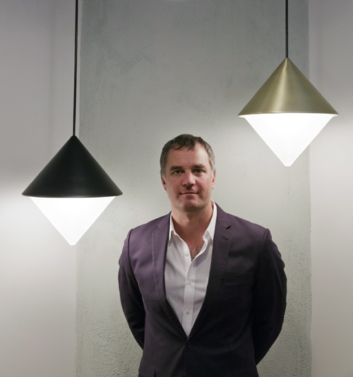 Roll & Hill founder and designer Jason Miller, photographed with the Half and Half Pendent designed by Jonah Takaji and Hallgeir Homstvedt