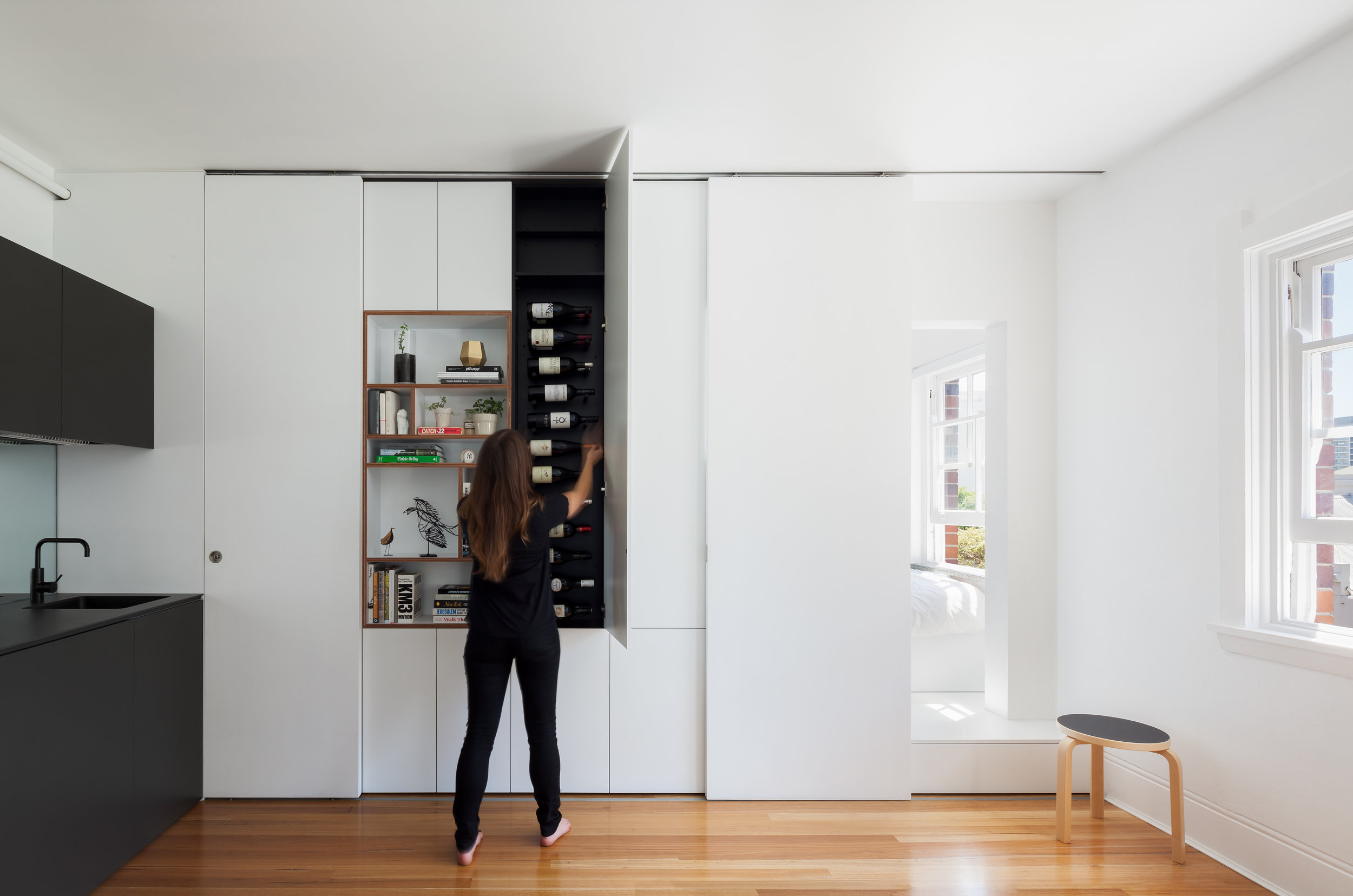 Small is not about compromise, even a 27 square metre apartment can accommodate wine storage if you think creatively. Photo by Katherine Lu.