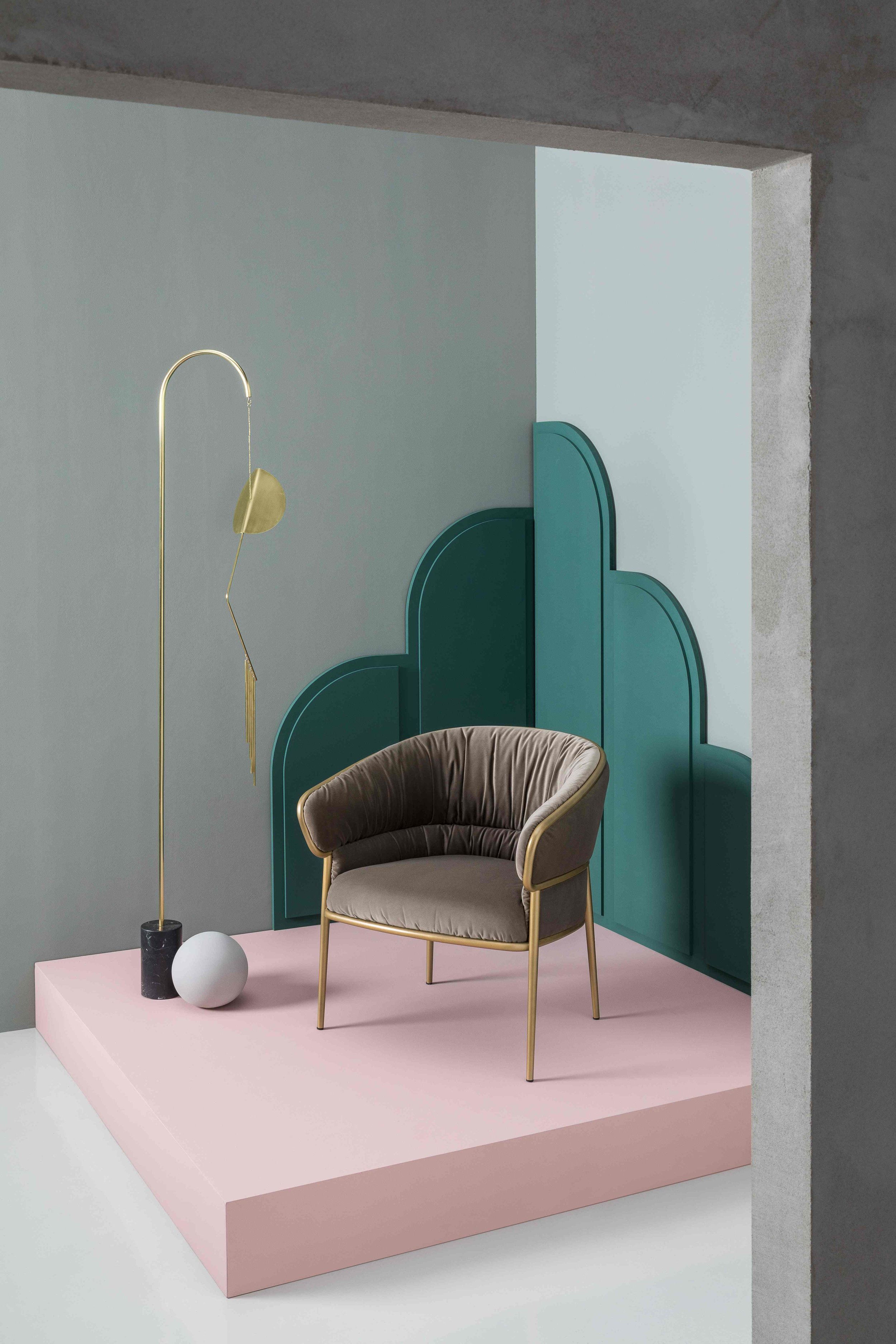 The Shu-Ying armchair includes intricate upholstery details that balance the softness of the seat and the form of the shell.