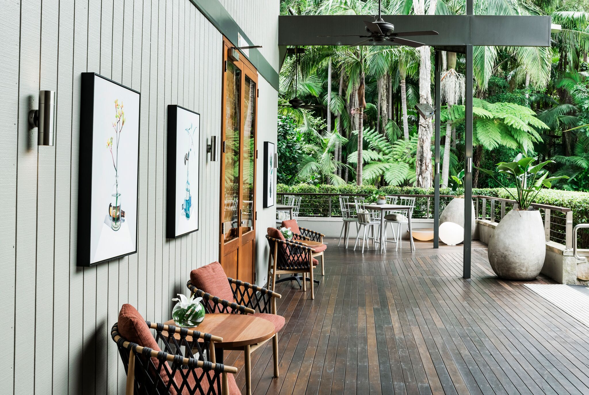 The verandah extends the indoors out and offers casual places to sit and relax. Photo by Michael Wee.