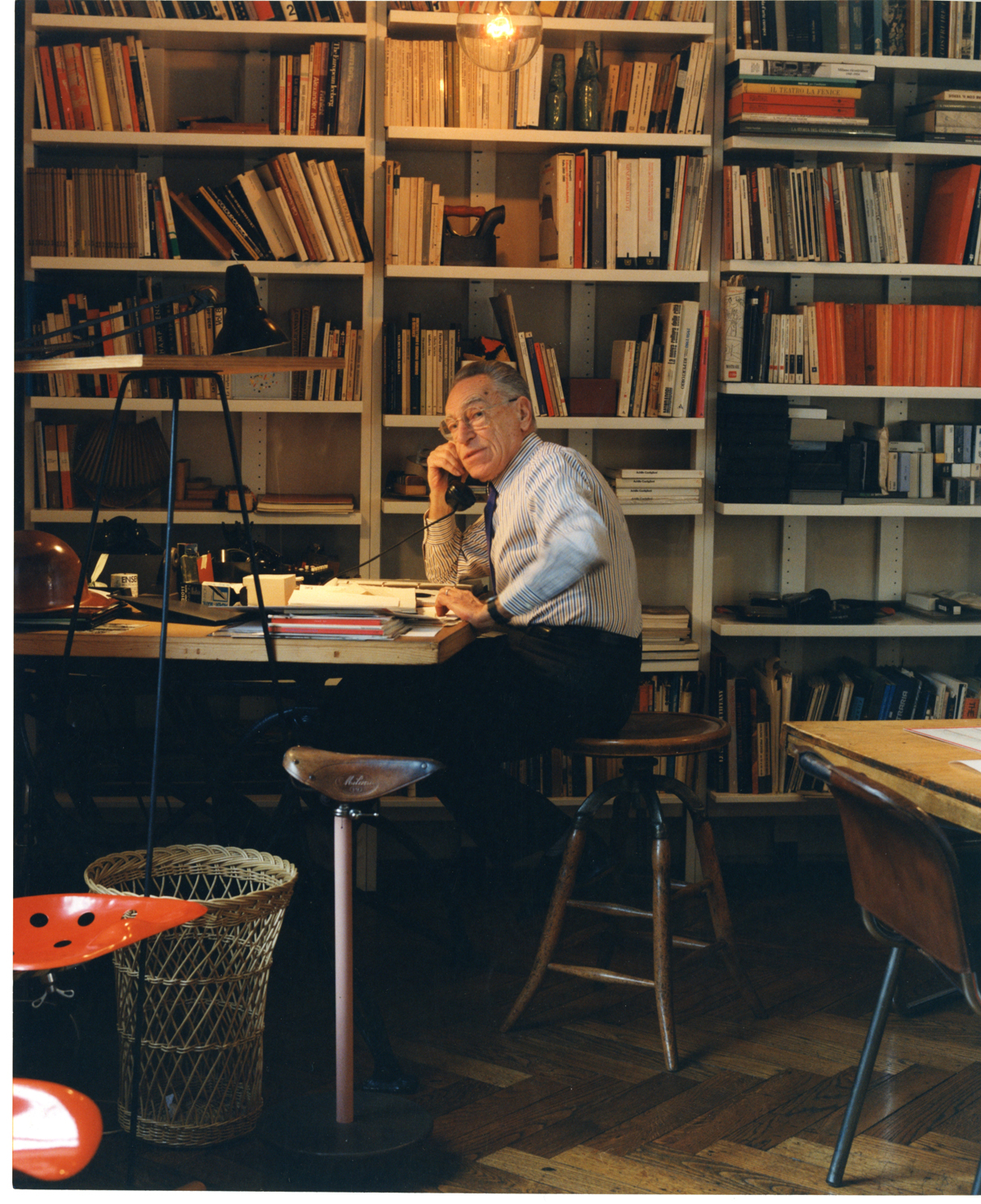 Achille in his studio in 1995, surrounded by his favourite things including the Sella and Mezzadro stools. Photo Foundation Achille Castiglioni.