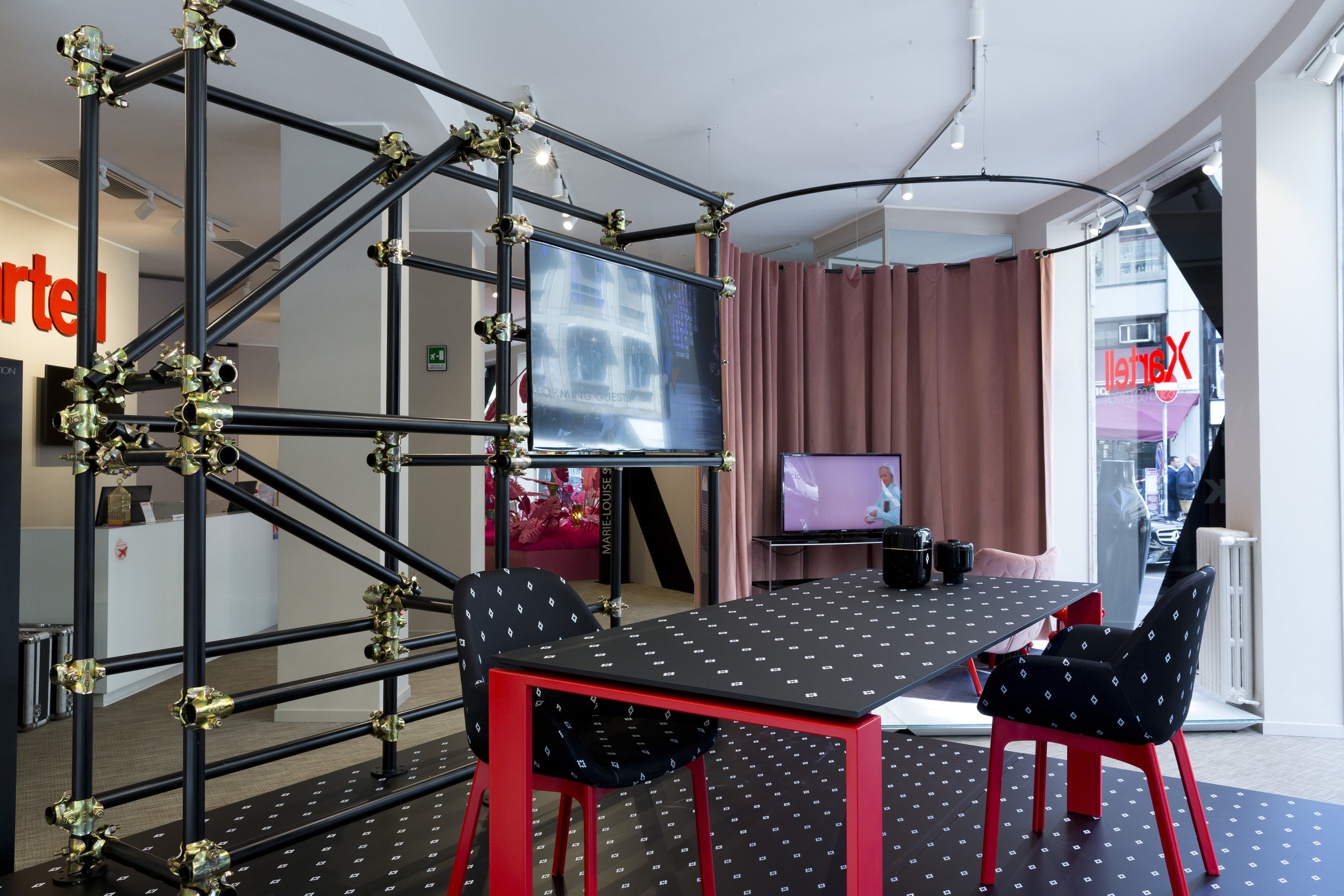 The 'Kartell Crossing Generation' exhibition at their Flagship store on Via Turata.