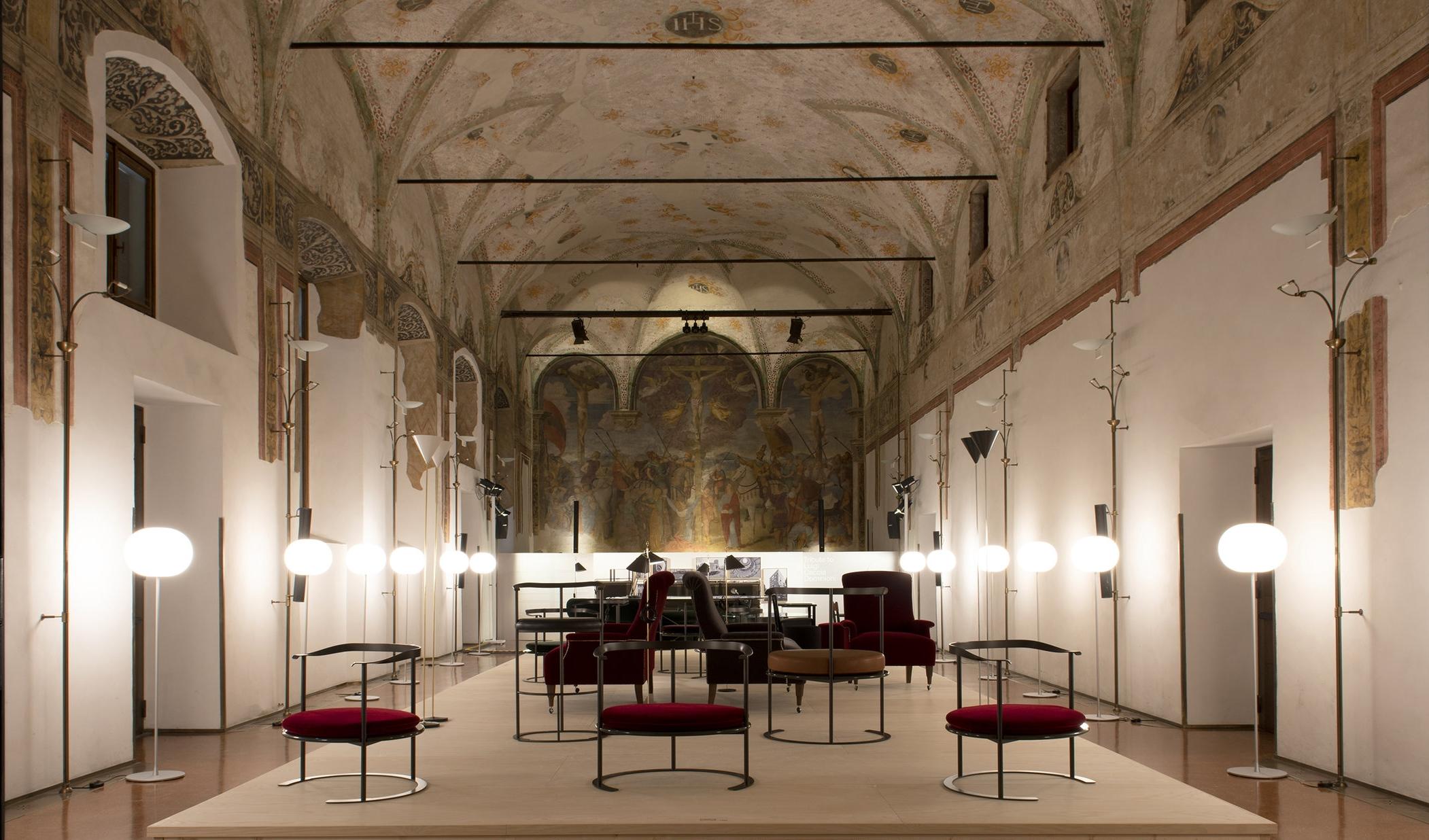 B&B Italia presented a collection of Luigi Caccia Dominioni's furniture inside the historic frescoed hall of the Umanitariain building.