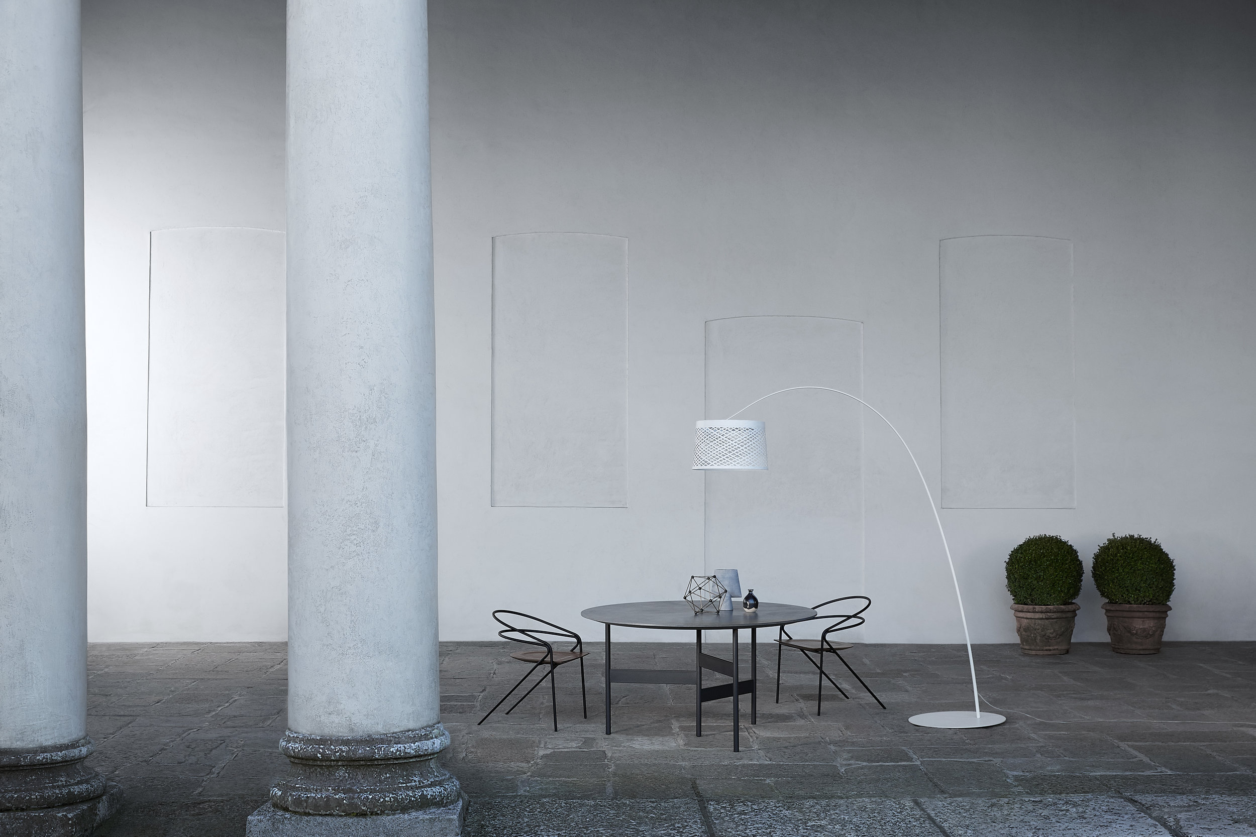 The new Twiggy Grid lamp by Foscarini on show at the impressively Baroque Palazzo Litta.