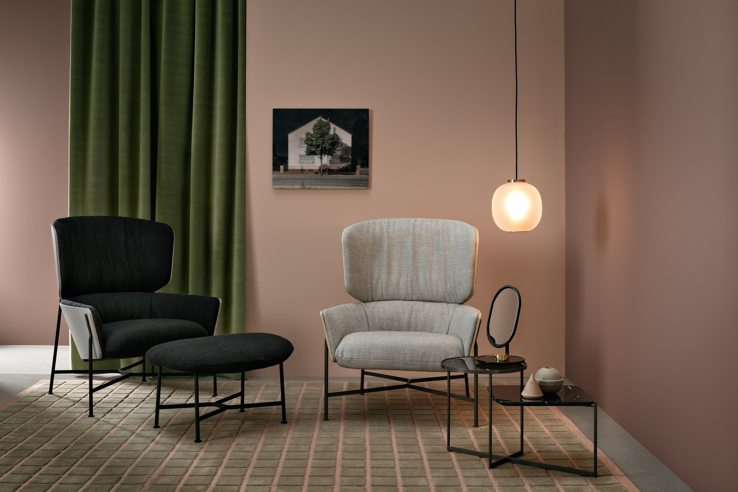 Tim Rundle's new collection for SP01 includes the Caristo armchair and ottoman, the Michelle mirror and the Mohana nest of tables, here with black frame and marble tops.