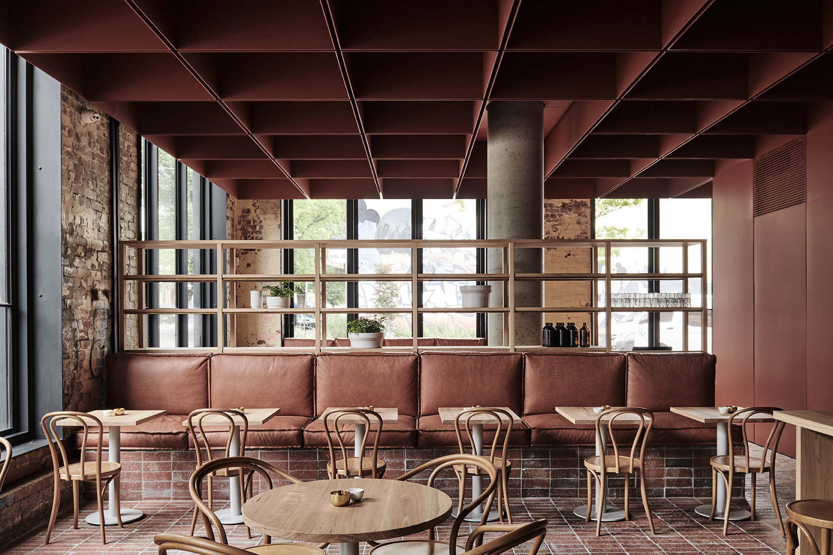 The Bentwood café in Fitzroy, Melbourne, tunes into the neighbourhood's local material palette and frames views.Photo Tom Blachford.