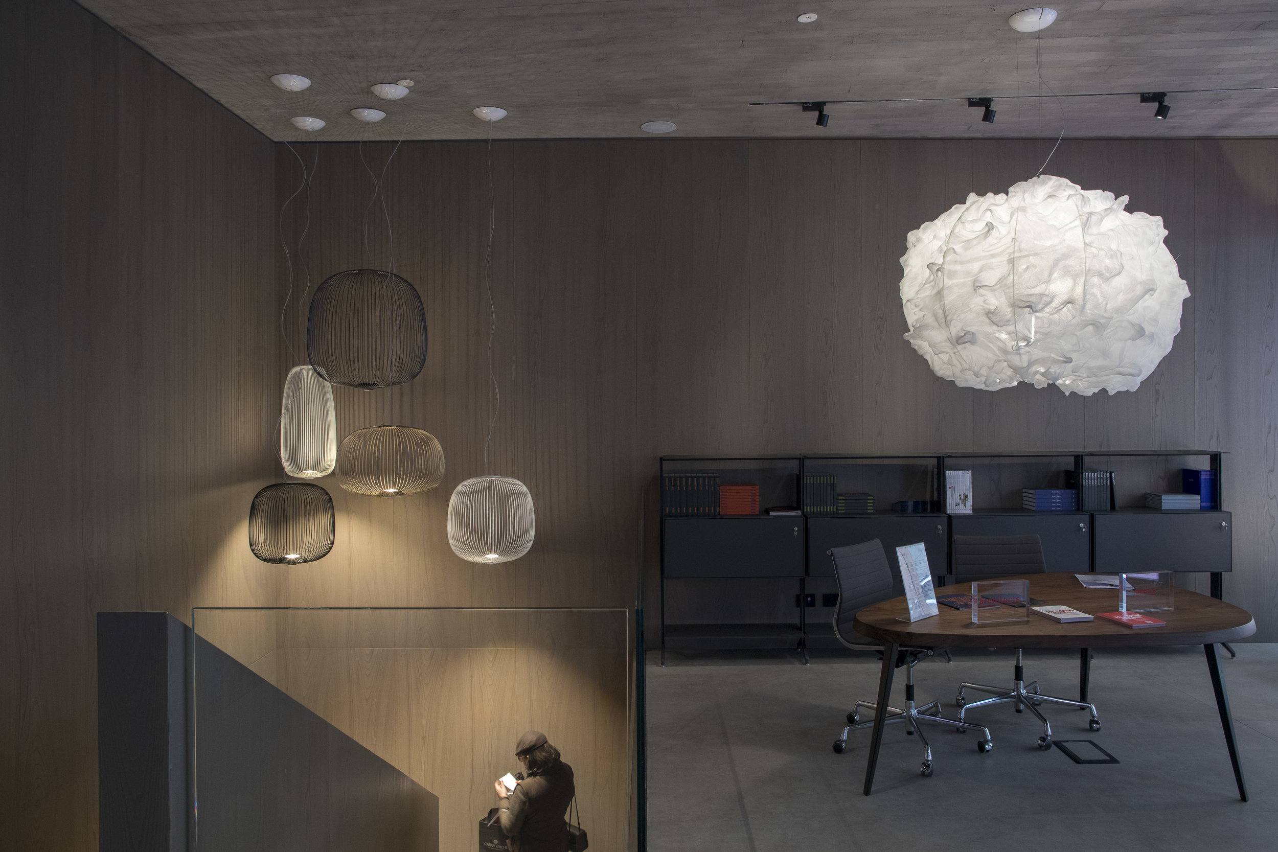The Nuée lamp (right) designed by Marc Sadler inside Foscarini's new concrete-lined Milanese showroom. Photo © Foscarini.