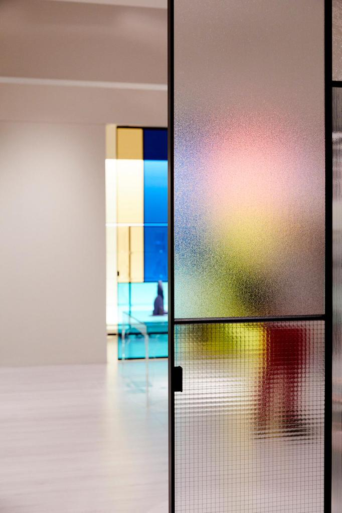 The Glas Italia stand with obscured glass and colour., a key theme of their new Sherazade Door collection.