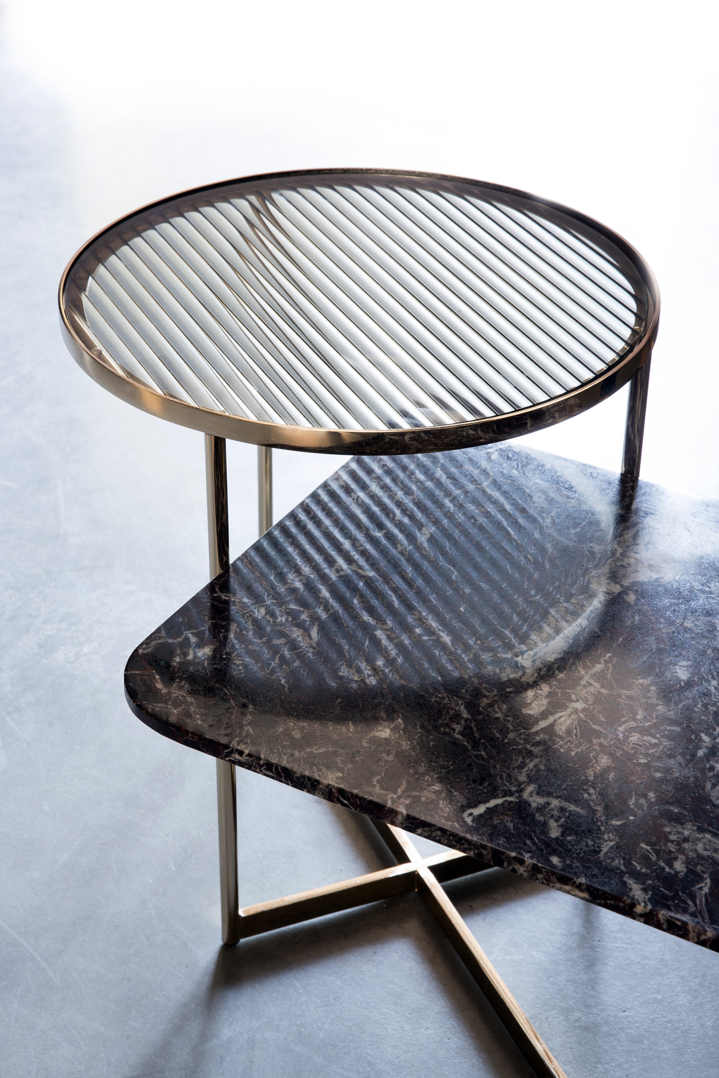Natural stone and detailed metalwork feature in the new Jeannette outdoor/indoor table series.