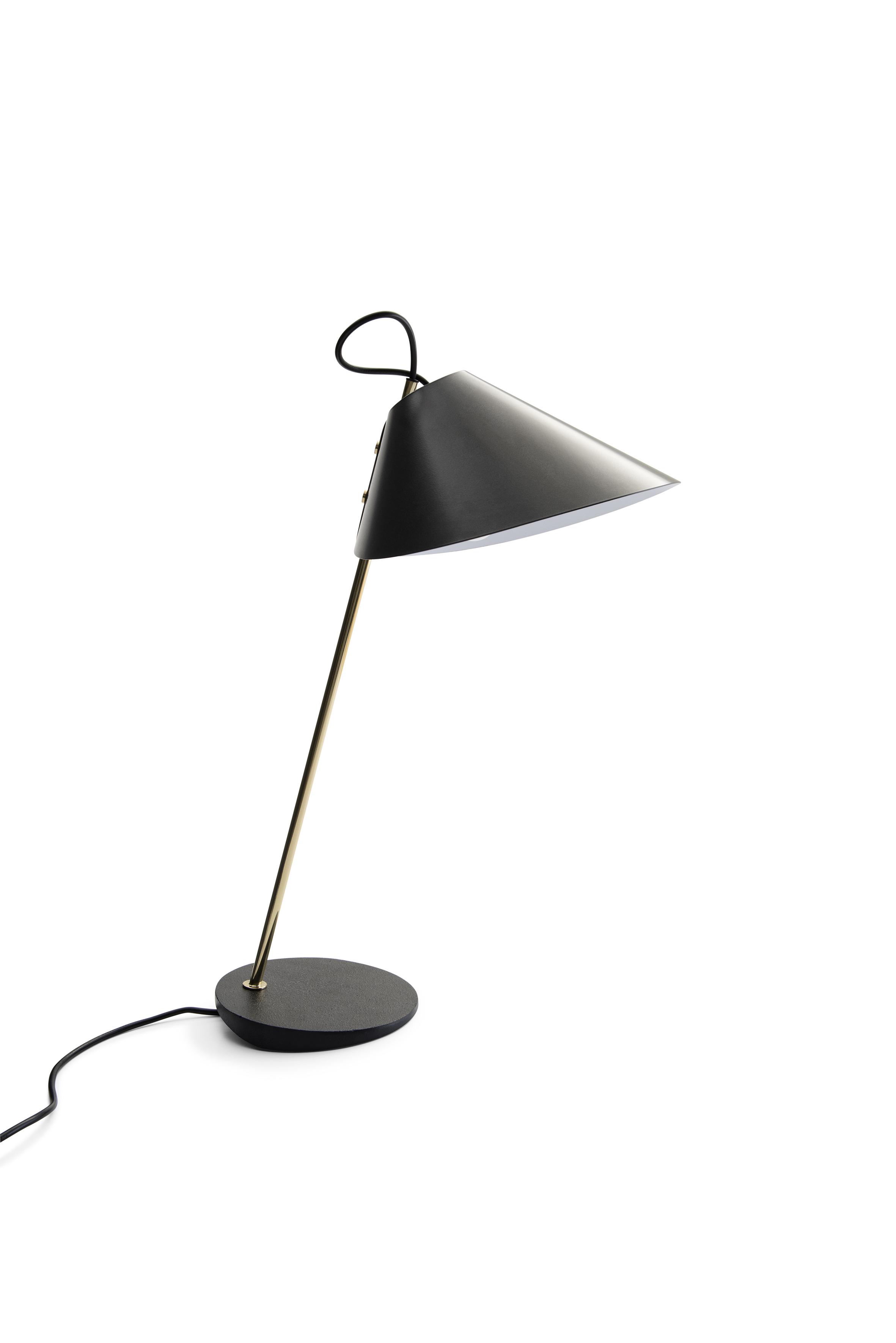 The Monachella table and floor lamp designed by Luigi Caccia Dominioni. Photo c/o B&B Italia.
