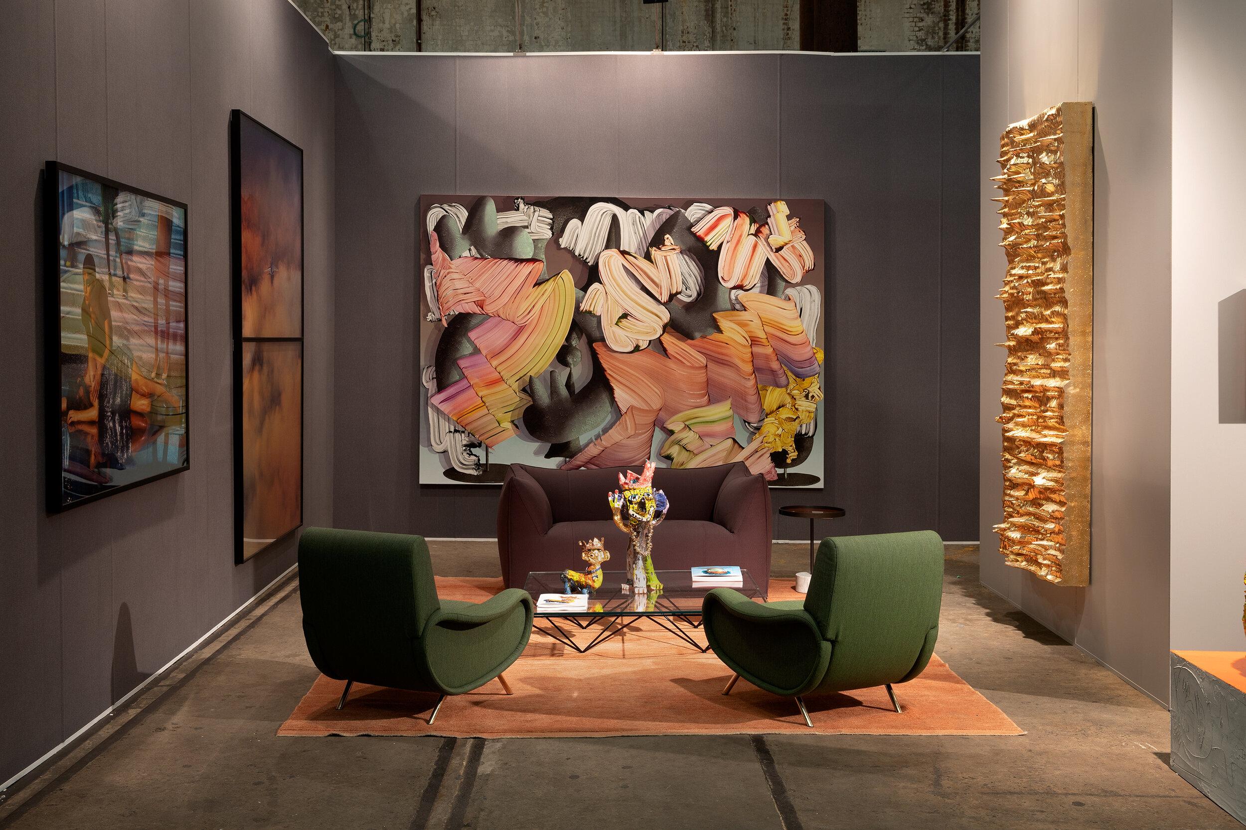 Cassina Lady armchairs and B&B Italia's Le Bambole Sofa sit comfortably at Sullivan & Strumpf's stand at Sydney Contemporary.