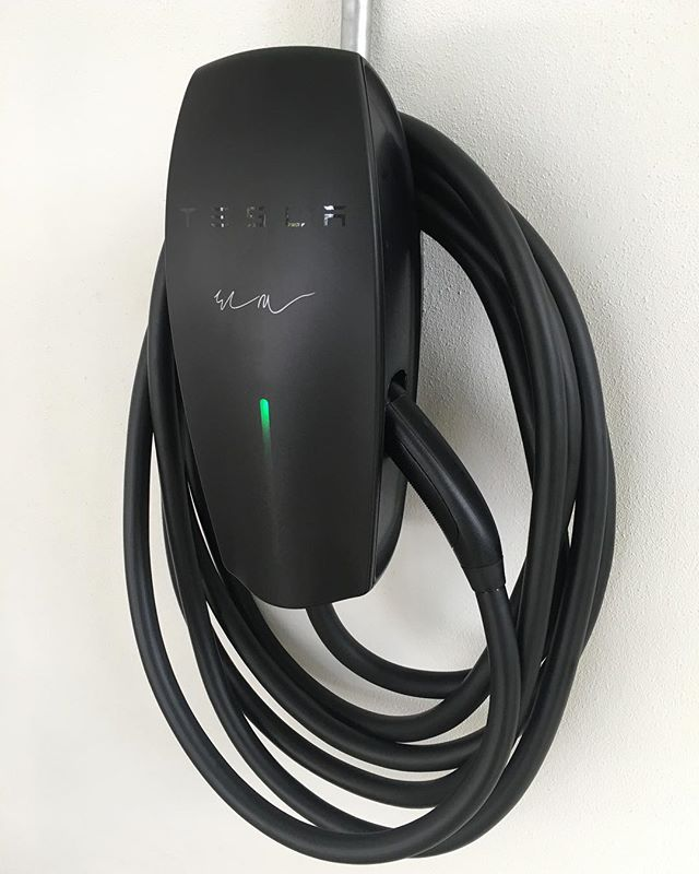 Installation of Elon Musk Signed Tesla Charger in #miami #tesla #elonmusk