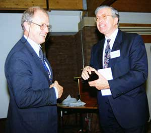 Ron Pigott (president that year) making a presentation to Arnold Huddart