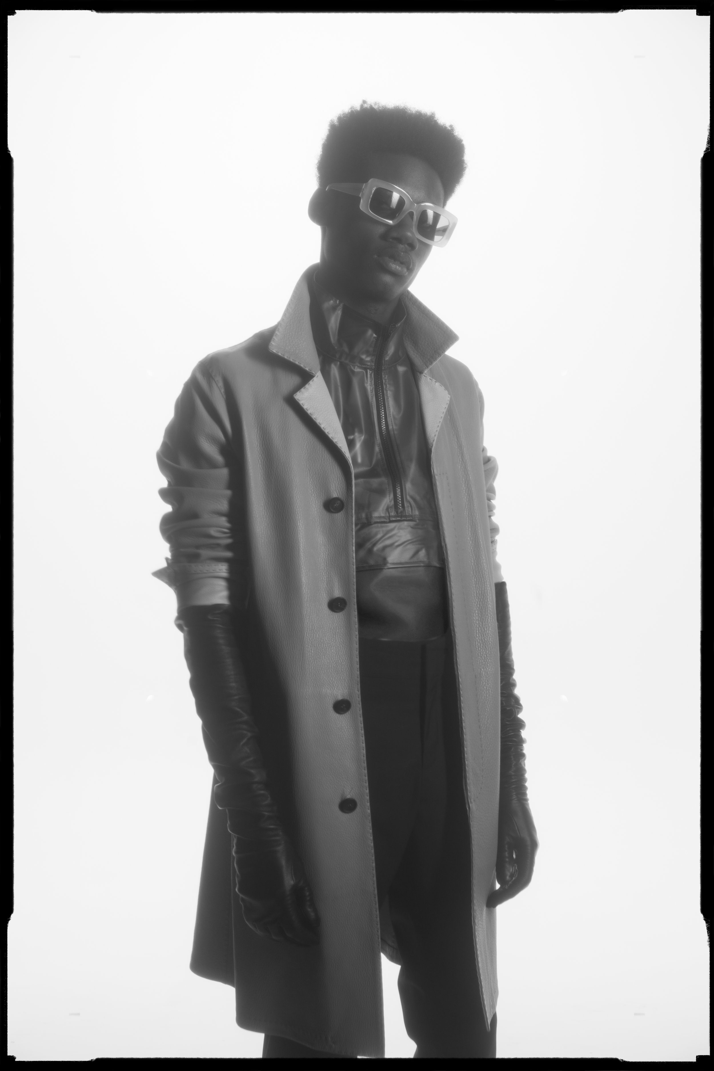 Leather coat and top by Fendi, pant and gloves by Moschino, sunglasses by Rein