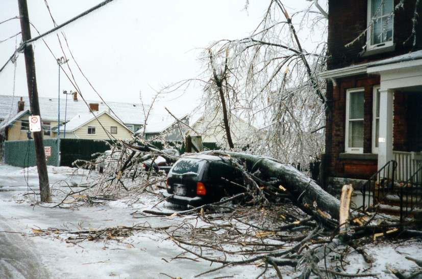 A smashed van in the aftermath of the 1998 ice storm.    Bill Stevenson via Flickr , shared with a  CC BY-NC-SA 2.0 license .