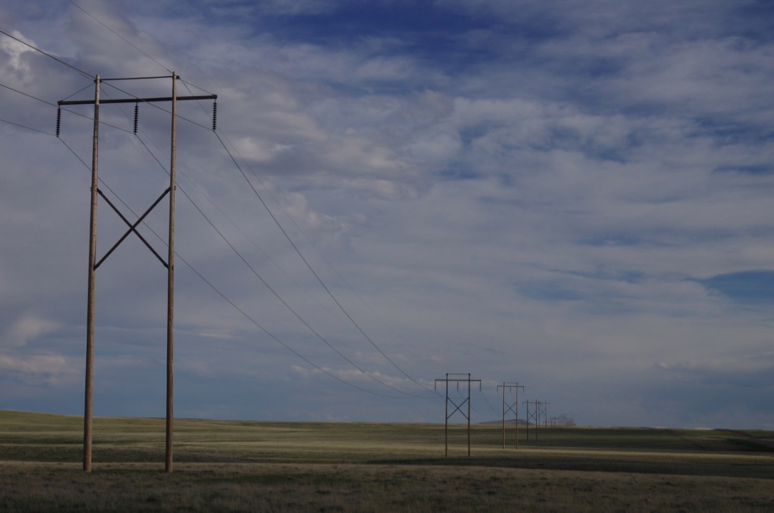 Power transmission lines march across the Shirley Basin in central Wyoming. Stephanie Joyce.