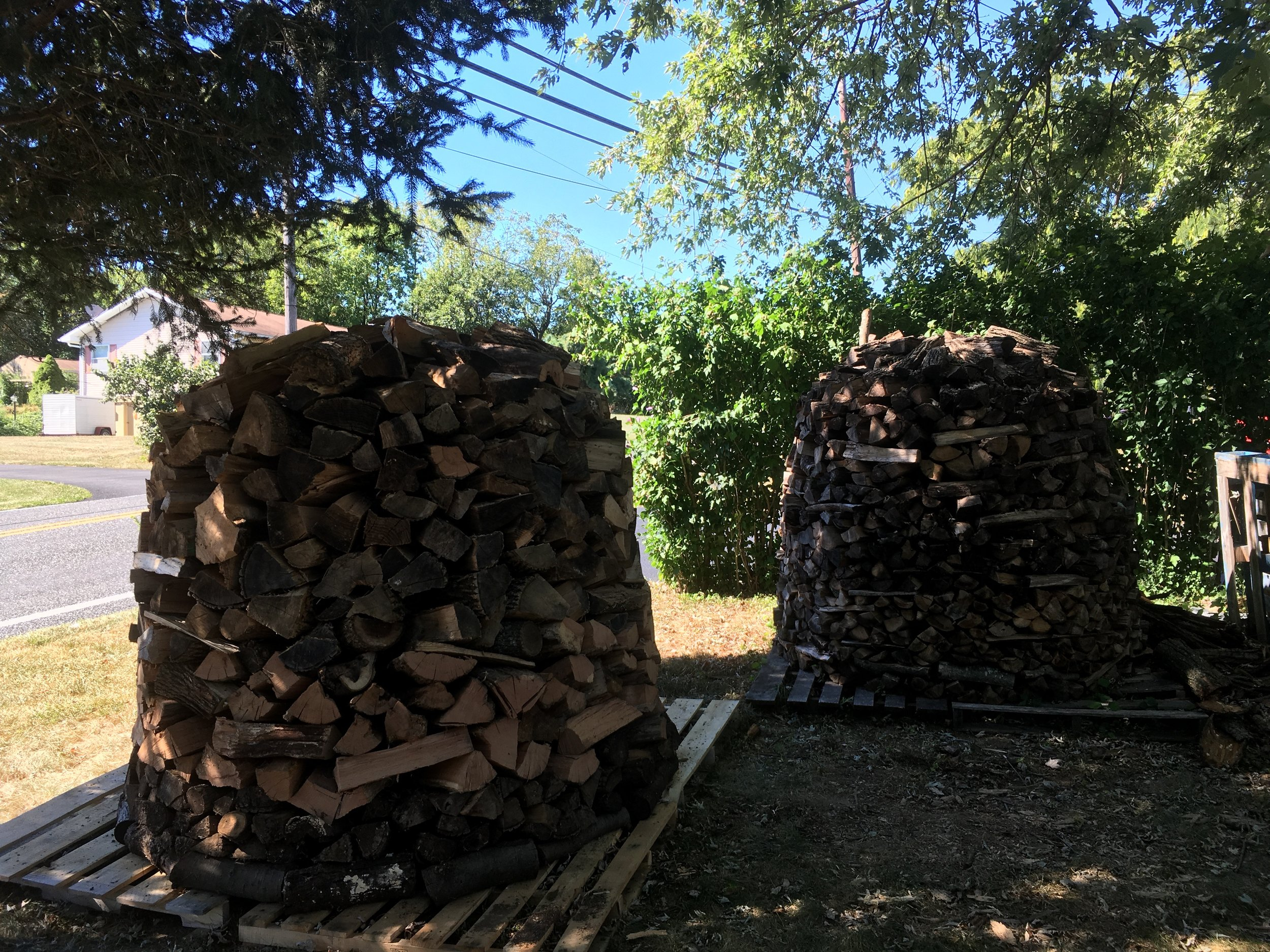 Two Holzhausen (German for wood house) I built recently. Combined they hold about 2.5 cords of wood. I've got one more I'm working on with just under 4 cords of wood saved up total. Should get me through this winter but I'd like to get 1 or 2 years ahead. I really like the concept behind these German wood piles. Not only are they much more economical and efficient than regular wood piles they look beautiful too.