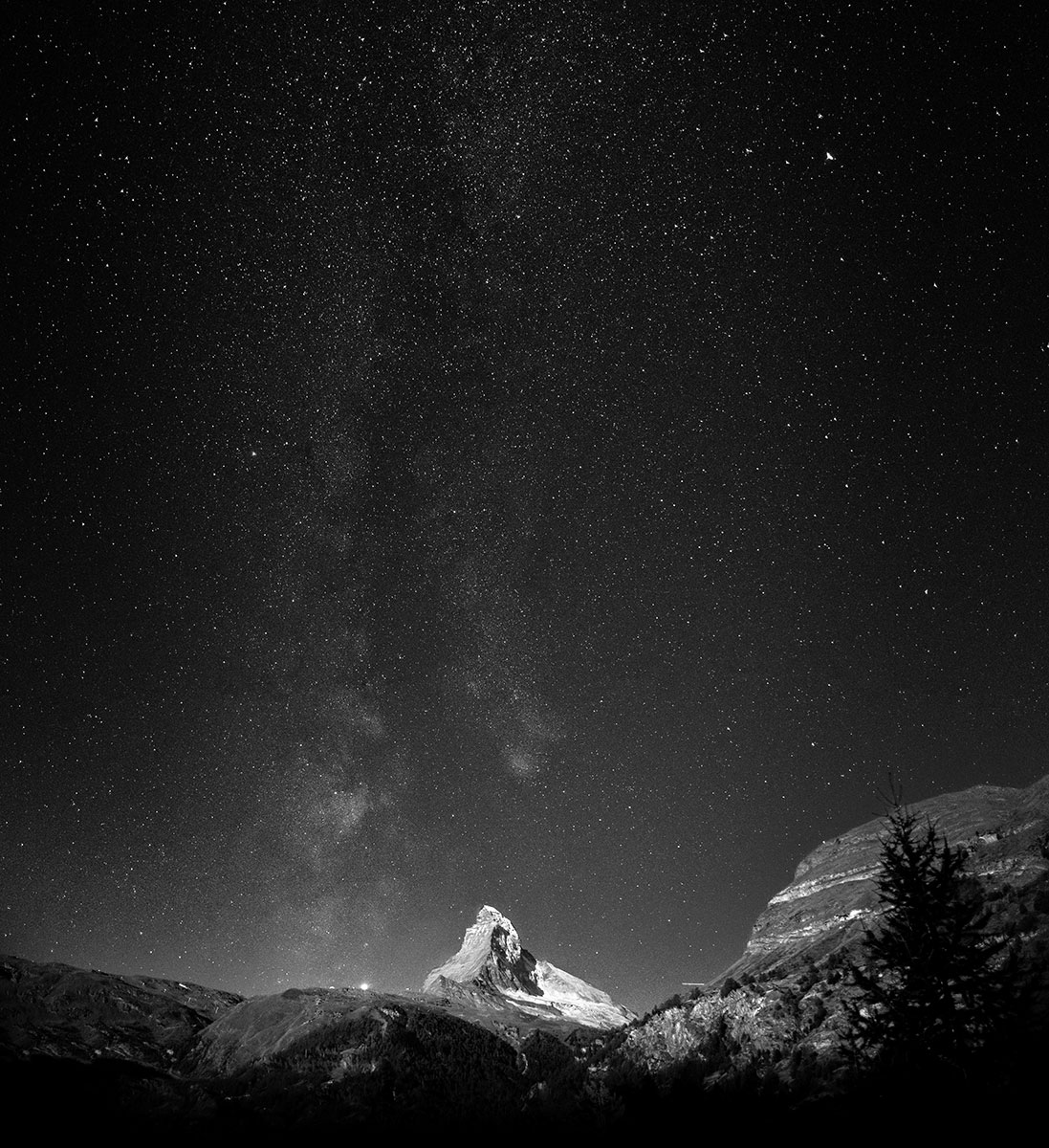 The milky way galaxy dwarfs the 4478m high mountain, the Matterhorn, during a late september night shoot