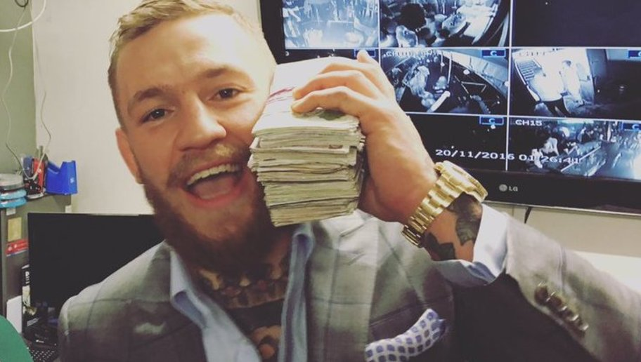 Conor McGregor holding the money phone