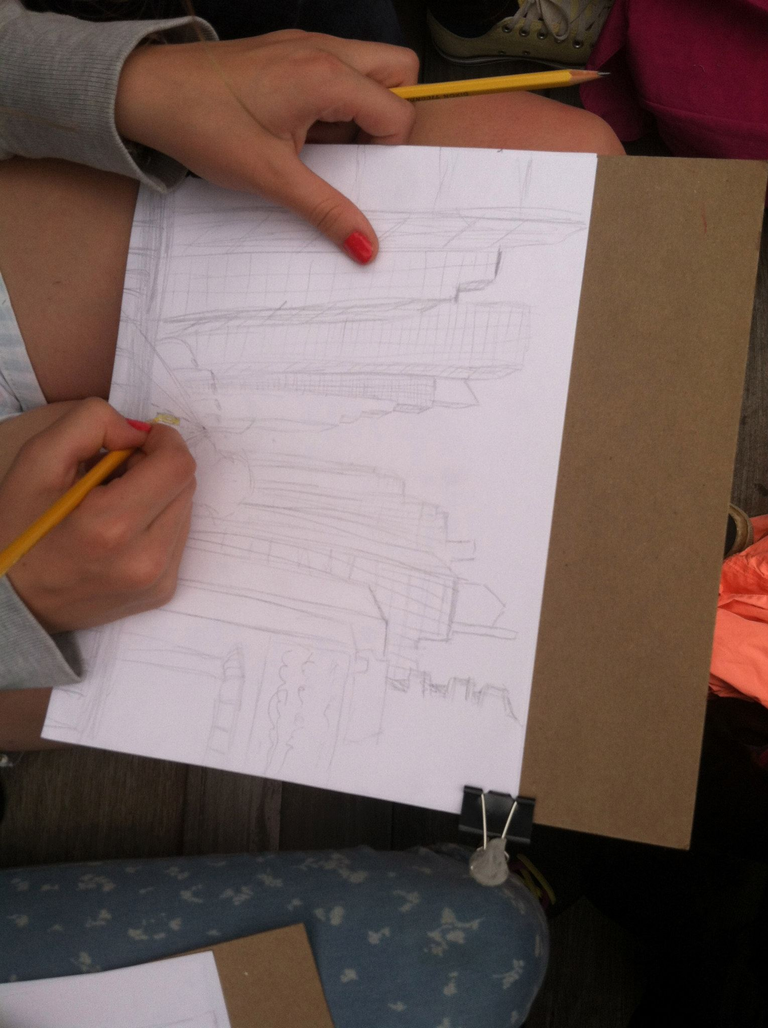 Students sketching outside in the park.