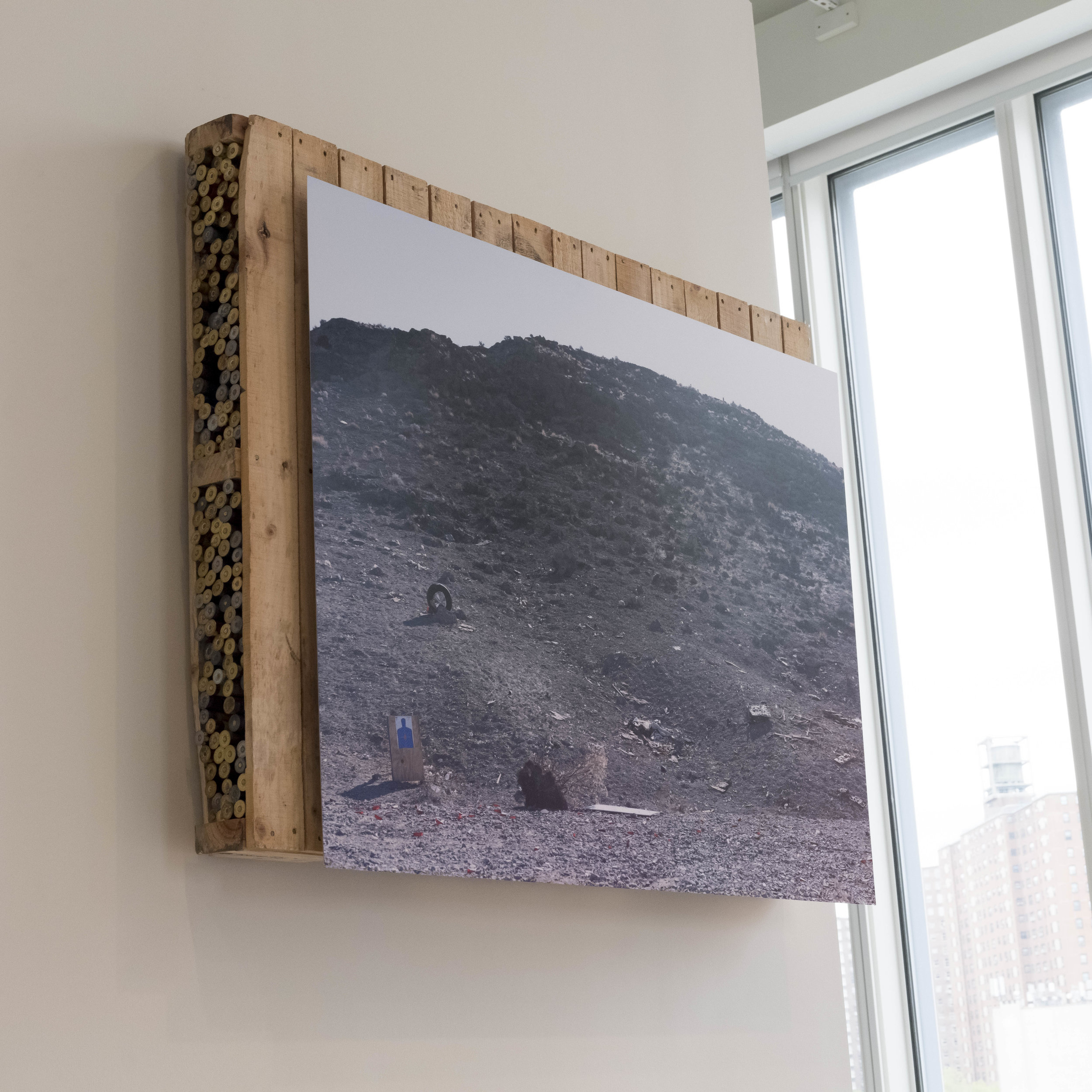"Shooting Range #2, 36""x48"", Dye Sub Aluminum Print, mounted on pallet, with found shotgun shells from HDSP area, 2019"