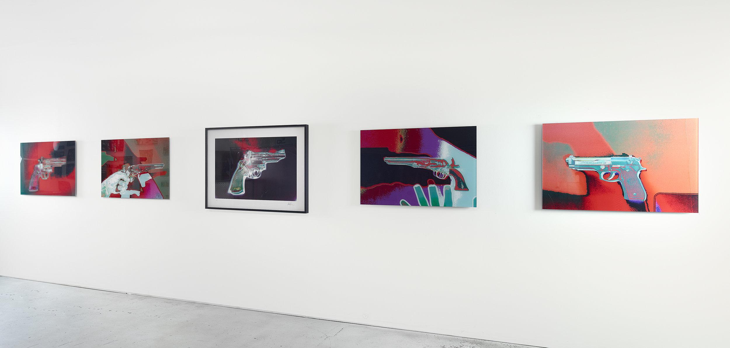 Gun show gallery wall.jpg