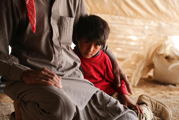 Abu Omar is worried about his children's education, or lack there of, owing to the nomadic life.