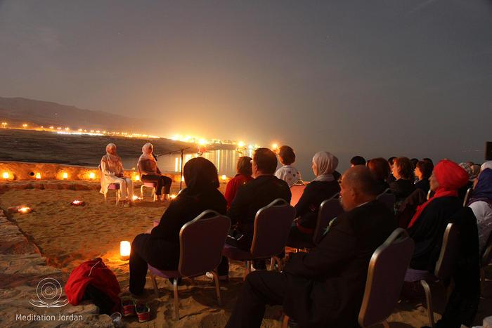 Mediation trainers Nesreen Khashman and Aseel Nassar lead the supermoon mediation beside the Dead Sea.