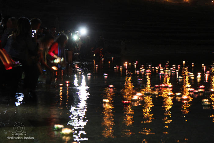 Meditators light floating Thai lanterns as an act of peace.