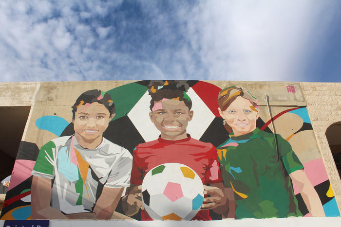 A mural in the Sweifieh district of Amman honours the national Under 17s Women's Football Team. (Charlotte Grieve)