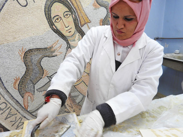 Student Hikmat Al Raham creates a mosaic at the Madaba Institute.