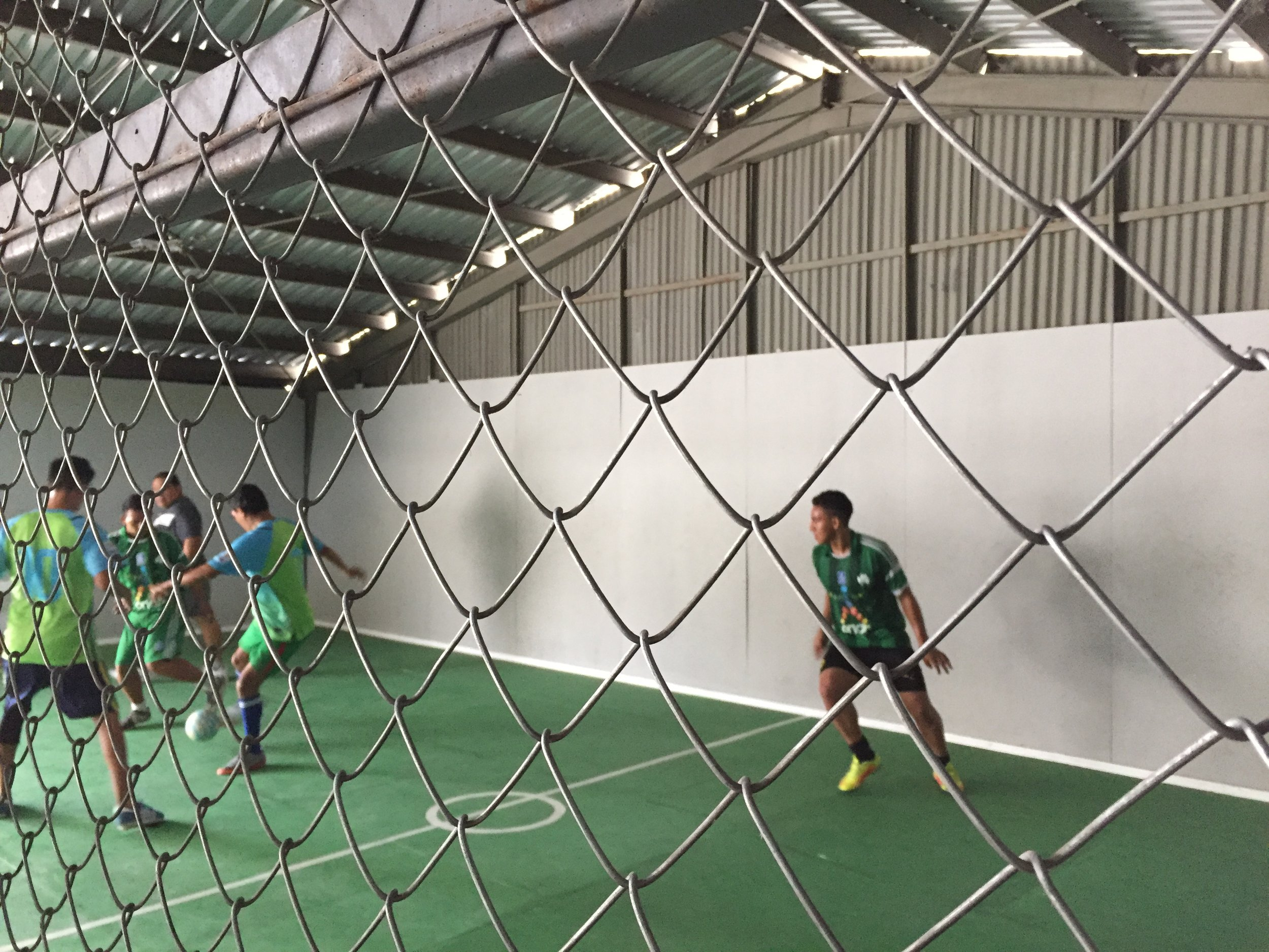 Two teams playing in the soccer tournament on Monday morning