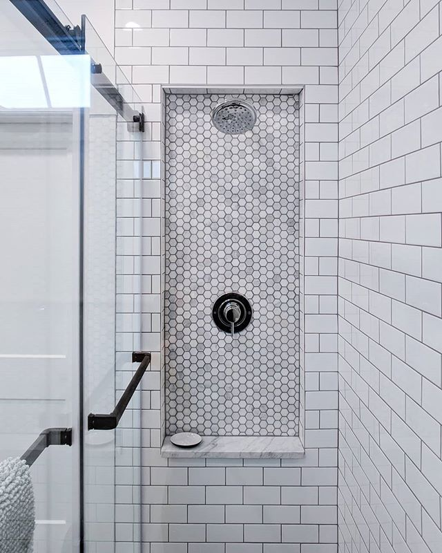 This beautiful marble shelf and penny tile are a nice detail in our Lunenburg reno. 🚨*Hot tip alert*🚨 Stonewrights Countertops in Bridgewater NS have a great assortment of marble offcuts to select from for all manner of creative use. 🚿🧖 ✨ . . . . #tiliabuilders #tile #tiledesign #marble #pennytile #renovation #interiordesign #beauty #simplicity #comfort #clean #shower #contractor #contractorsofig #tilia #builders #halifaxnoiseathome
