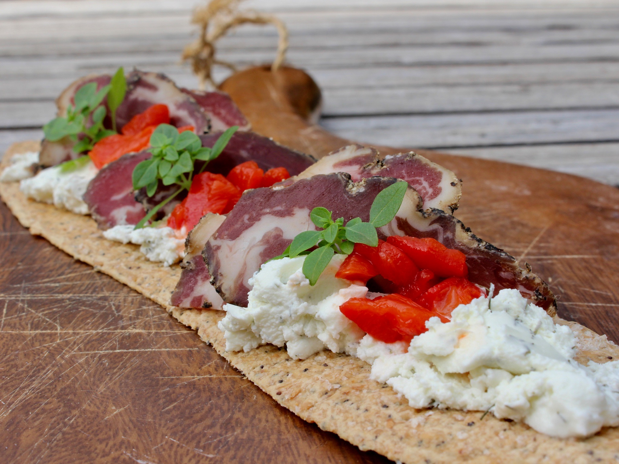 lavash, goats' cheese, cured meat