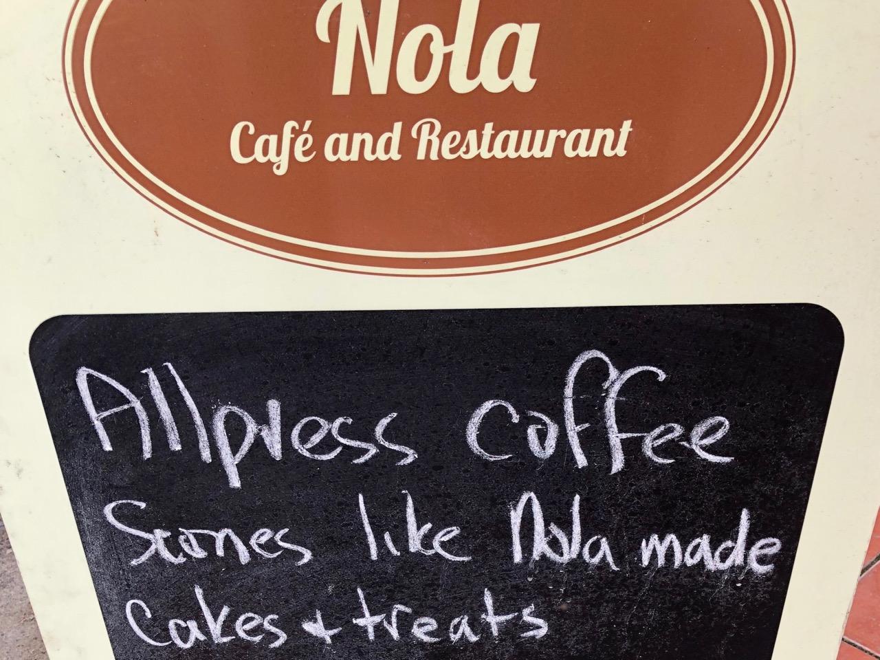 Nola cafe sign