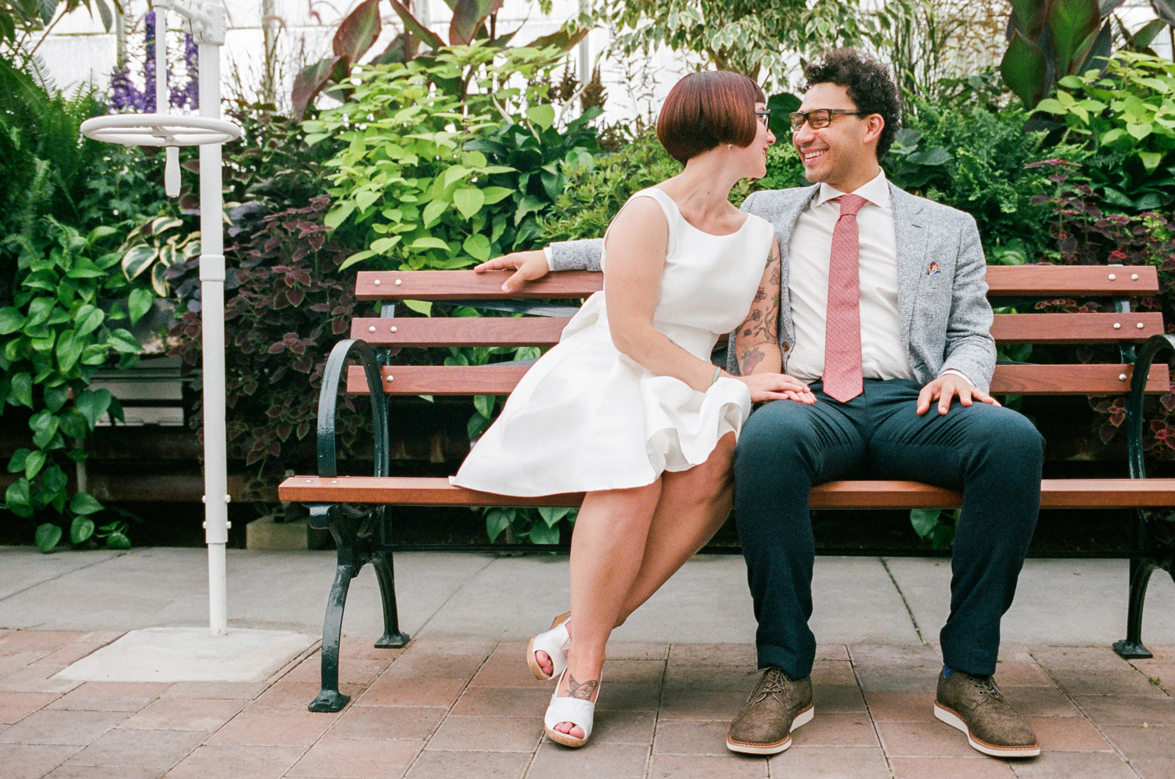 Bride and Groom Portraits at a Volunteer Park Conservatory Wedding with the bride wearing Kate Spade.