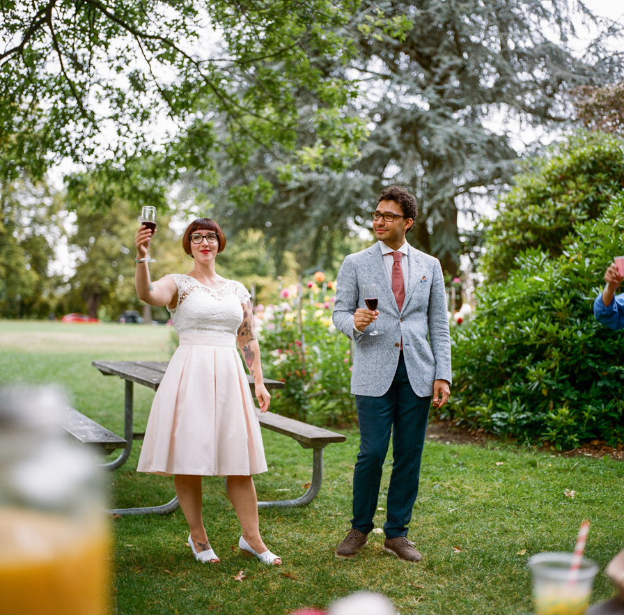 Toasts in the park from a Volunteer Park Conservatory Elopement.