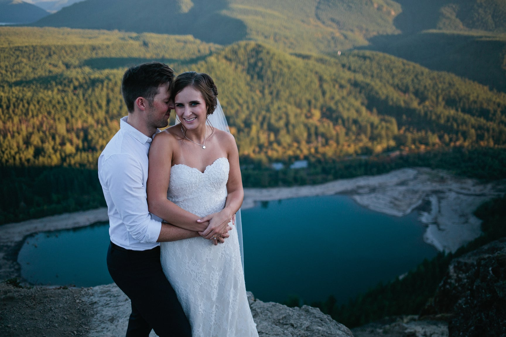 Bride and groom at Rattlesnake Ledge by Alexandra Knight Photography.